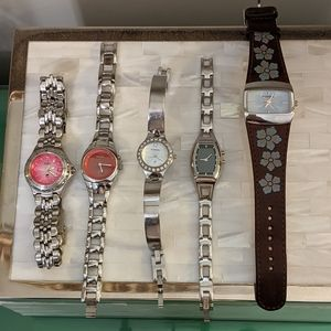 Five Fossil watches